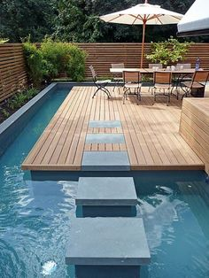 gorgeous pale decking and pool with floating path