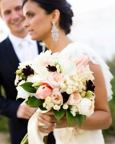 The Bouquet    Gauri carried a bouquet of garden roses, dahlias, calla lilies, button mums, and chocolate cosmos.