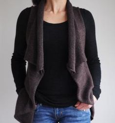 Julie Hoover Decouverte Worn over a sleeveless tank in warm weather or with your favorite turtleneck in cold, this draped collar vest will be a chic addition to your everyday wardrobe. The oversized fit and open front flatters every figure, and keeps you just a little bit warmer when you need it. Chest measurements of 32 (35, 38, 41)-inches. You will need 3 skeins of Swans Islands Fingering weight yarn, US 5 16-inch and 24-inch circular needles OR size needed to obtain gauge. Gauge is 24 stitches and 32 rows over 4-inches.