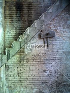 old stairs along bricked wall. - Image of old stairs along bricked wall.