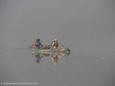 Eurico, Tonico, Norberto, and Hercilio paddling in the cool morning fog on the Rio Branco. Dawn was the best time to paddle because the fog ...