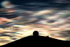 Polar stratospheric clouds over McMurdo base. Photo by Deven Stross (@Ross Fishkind' island).