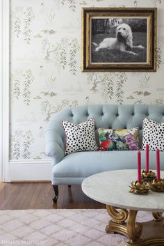 Couch, spotted pillows {furniture} {textiles} {living room}