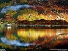 I want to live in that little white cottage on the loch's edge!