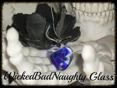 "This beautiful cobalt blue & clear glass lampwork heart has been carefully wound on mandrel with Italian glass & flame by the artist in the WBN Studio, Plano, Tx. USA. The heart is 1"" in length, has been kiln annealed for strength & durability & paired with silver beads & cobalt blue Swarovski crystal. It comes on a silver plated, 18"" chain with a lobster clasp. WBN Cobalt Blue Heart of Glass $30.00 USD For More Glass Addictions: http://WickedBadNaughty.com"