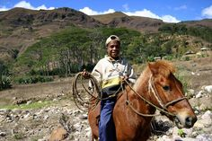 Boy on horse with lassoo, East Timor