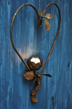 * outdoor decorations, blue doors, metal, candle holders, heart art, candles, blues, garden wall, tea lights