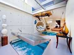 Designed by Weir Phillips Architects, this unusual apartment is located in Darlinghurst, New South Wales, Australia. A swimming pool integrated into the living room is what make it so unique. The pool itself is covered with a glass surface you can walk on where there is nobody in it.