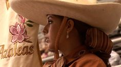 Escaramuzas are the women that side saddle ride their horses in the sport of Charreria