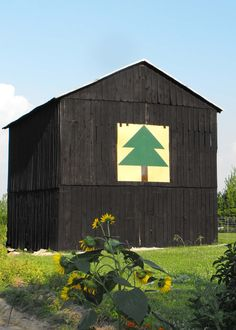barn with painted quilt. barn quilts are large-scale quilt squares painted on plywood or directly onto the outside of barns to celebrate the tradition of quilting, the enduring majesty of rural barn structures and all the communities whose shared appreciation has turned this local art form into a national phenomenon.