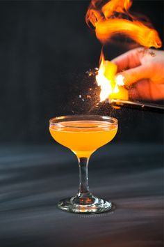 This striking tangerine cocktail is a perfect Halloween treat for adults. Made with vodka, Aperol, and tangerine, with a flaming orange twist.