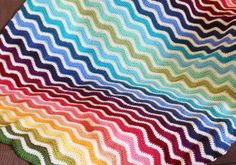 """Rainbow Ripple Afghan - link to a great tutorial, though the blanket is pretty simple to work up and the pinner says that after the first couple of rows it's """"almost impossible"""" to make a mistake."""