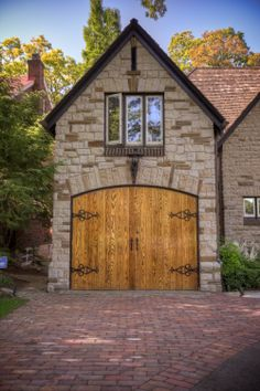 A gorgeous alternative to a garage or shed, with a #stone exterior, and gothic style doors.  #design