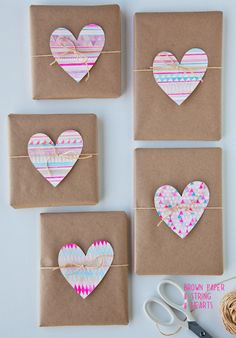 Adorable brown paper wrapping with twine and heart cut outs! I'm doing this at the next possible occasion.