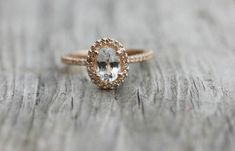 This EidelPrecious oval white sapphire ring set in rose gold is an example of: an unusual stone, an unusual metal (rose gold), a pavé band and a halo. A comparable ring costs about $1,160.