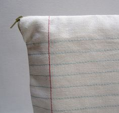 Sew blue and red lines to make fabric look like lined paper