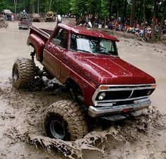 big red truck in the mud