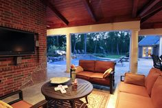 Another view of #outdoor #living #area. Both outdoor living and #kitchen designed for year round use. With air conditioning directed at ceiling fans (5) and #designed to maximize airflow. Fire place with special heat retaining #bricks warms entire area #tijiolos #klinker #bricks
