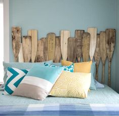 Sleeping with oars... New and old paddles are used to construct this headboard.