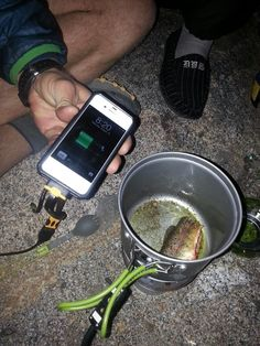 Cooking trout and charging smartphone simultaneously w/ the PowerPot from @powerpractical