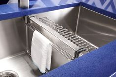 The Kohler Strive sink has a bottom basin rack to prevent scratching and it also has a center rack for holding sponges and hanging dishcloths.