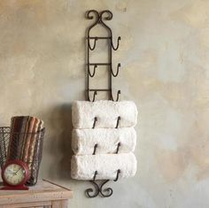 Magazine and wine racks for towels.