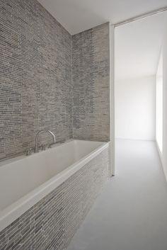 Nice bath with gray tiles.