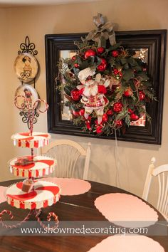Christmas wreath-French Country  layered over a mirror brings Christmas decor to this breakfast area.