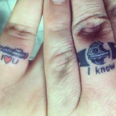 """Not many people would consider """"The Empire Strikes Back"""" as befitting of everlasting love, but """"Star Wars"""" fans are an unorthodox bunch, as evidenced by the unique tattoos a married couple got in lieu of wedding bands. geek, tattoo idea, star wars wedding, wedding ring tattoos, finger tattoo, wedding tattoos, a tattoo, wedding rings, couple tattoos"""
