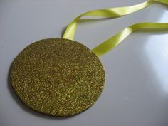 Olympic medal; CD and glitter. Olympic torch craft - it's just too easy!!!!!   For more Olympics craft and teaching resources, see - http://pinterest.com/cleverclassroom/olympics-2012/