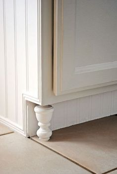 Great idea - finials as feet for kitchen cabinets  I actually seen someone do this before. They made their cabinets look like a large hutch.