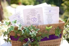 Programs in a decorated basket.
