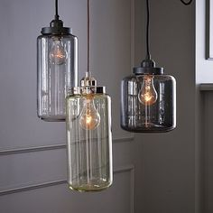 Antique glass jars inspired these softly glowing, industrial-chic pendant lights, which come in a palette that recalls the greens and grays of vintage bottles. Casting a cool glow over tables, counters and desks, these sculptural lamps work well as single pendants, but they're especially head-turning when hung in pairs or multiples at different heights.