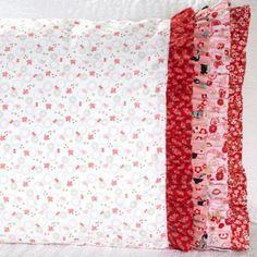 Benartex Fabric Used: Cherry Blossom Festival by Mitzi Powers for Benartex Download free ruffle pattern here: http://www.allpeoplequilt.com/millionpillowcases/freepatterns/Pillowcase-36.pdf