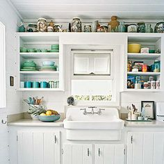 Showcase shells and other beach finds above kitchen cabinets for a rustic, cottage-like feel. | Coastalliving.com