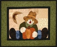 """Straddling Scarecrow Applique Wallhanging Pattern by The Wooden Bear at KayeWood.com. One of our """"Straddling Series"""" quilts, this fall wallhanging has a pieced background and borders with applique scarecrow and pumpkin. Each quilt in our Straddling Series is pieced the same way and all measure 19 1/2"""" x 23 1/2"""", making them easy to switch for all the seasons.http://www.kayewood.com/item/Straddling_Scarecrow_Wallhanging_Pattern/3476  $8.00"""