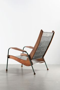 Jean Prouvé; #352 Galvanized Steel, Sheet Metal, Enameled Metal and Wood, 'Colonial' Armchair Variation, 1952.