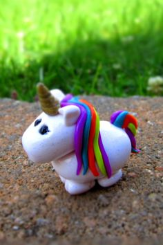 Polymer Clay unicorn. @Kaitlyn Marie Mattson Curnow learn to make this... then give it to me!!