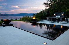 negative edge pool with fire feature by Valley Pool  Spa
