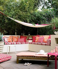 A terrace gets a bold pick-me-up from cushions in vibrant colors (tangerine, fuchsia) and modern prints like ikat, stripes, and eye-popping florals.