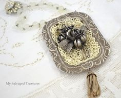 Lace, broken jewelry, and a little tray