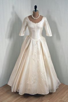 Wedding Dress, Kauffman: 1950's,  Chantilly lace appliqued silk satin.