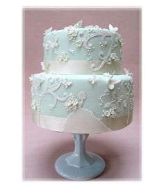 Pale Blue Wedding Cake With Ribbons And Pearls