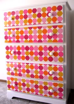 Fun Dresser - The front of these drawers get a revamp with Mod Podge and polka dotted wrapping paper