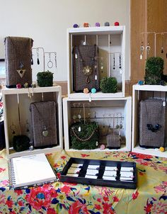 cover bricks (or light empty boxes!) with burlap or other fabric for display necklaces