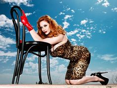Christina Hendricks curvey goodness in a strapless leopard print mini dress andcsky high heels. Provacative yet dumb pose.