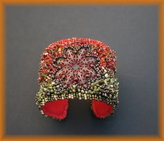 Bead embroidered cuff - My summer garden. €135,00, via Etsy.