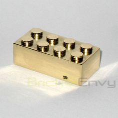 Official LEGO bricks created out of 14k solid gold were originally given out to LEGO employees with 25 years of experience.   Golden LEGO brick was recently sold for only $14,449.99 by Brick Envy.  World's most expensive LEGO brick is compatible with plastic bricks.