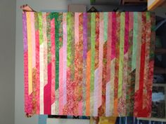 Jelly roll race quilt made by Donna McQueen. Made with Bali Pop in watermelon. So easy, so fast!
