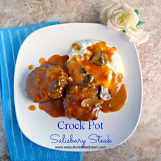 Salisbury Steak with a rich, tangy gravy that is made in the crock pot! A recipe from Seduction in The Kitchen